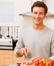 man cooking healthy